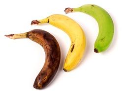 ripe, overripe, green bananas on white background