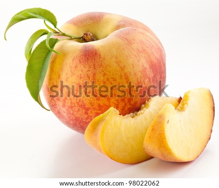 Ripe peach fruit with leaves and slises on white background.