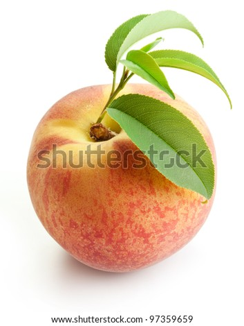 Ripe peach with leaves isolated on a white background.