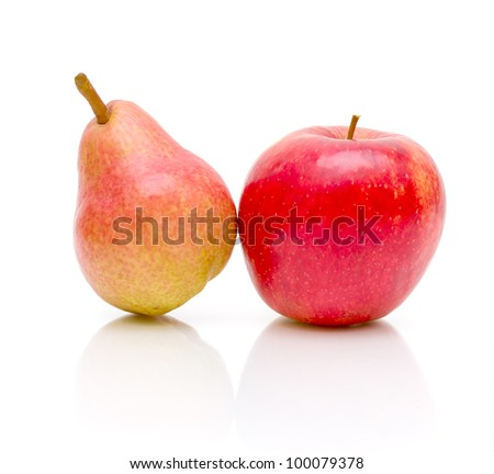 ripe pear and apple on a white background close-up of the reflection