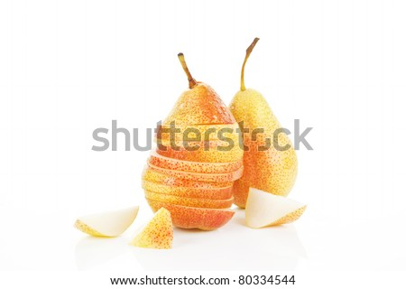 Ripe pear background. Slices, pieces and whole pears isolated on white.