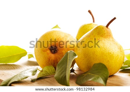 Ripe pears closeup on wooden table