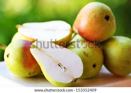 Ripe pears on table