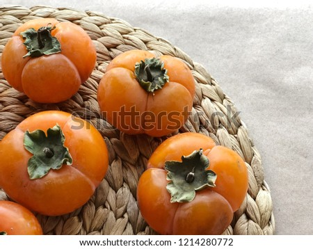 Ripe persimmon fruits. High resolution photography.