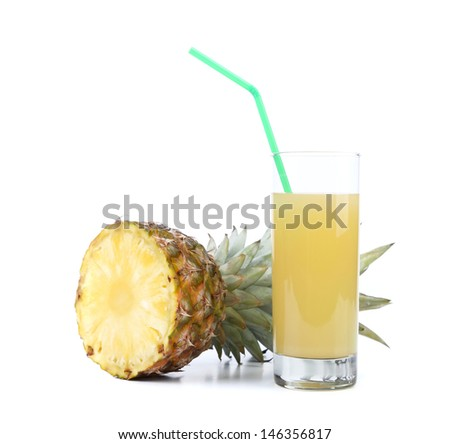 Ripe pineapple slice and juice glass
