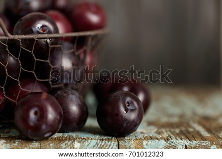 Ripe plums on a dark background. Macro photo. Selective focus.  #701012323