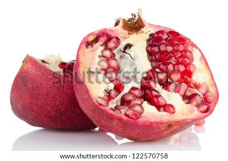 Ripe pomegranate fruit with half isolated on white background.