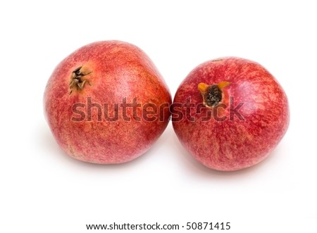 Ripe pomegranate seeds isolated on white