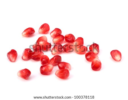 Ripe pomegranate seeds  isolated on white background