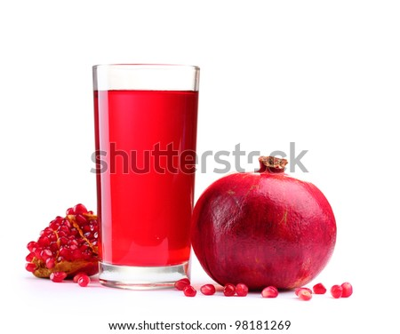 ripe pomergranate and glass of juice isolated on white
