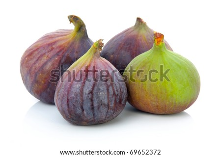 Ripe purple and green fig fruit isolated on white background