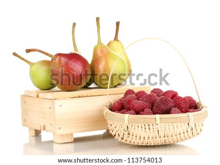ripe raspberries in basket and pears on crate isolated on white