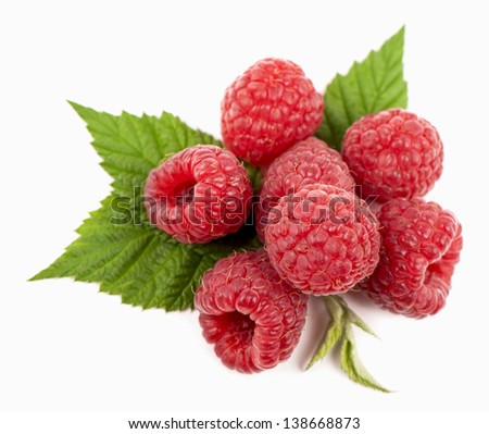 Ripe raspberry with green leaf on white background