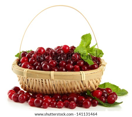 Ripe red cranberries in basket, isolated on white