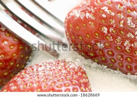 ripe red strawberries coated in sugar granules
