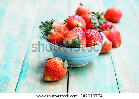 Stock Photo Ripe red strawberries on green wooden table, Fresh strawberry, Strawberries in  white bowl.