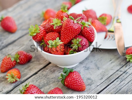 Ripe red strawberries on wooden table