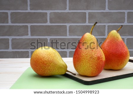 Ripe, ripe, reddened pears on the table.