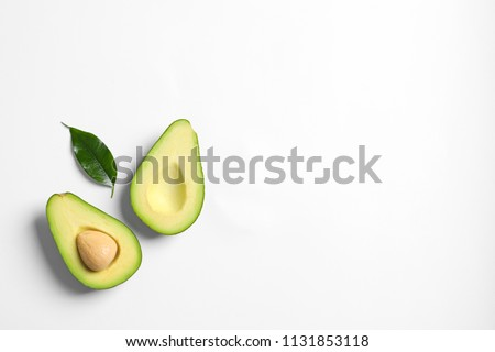 Ripe sliced avocado on white background
