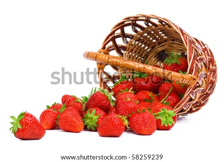 Ripe strawberry in wicker basketbasket isolated on a white background