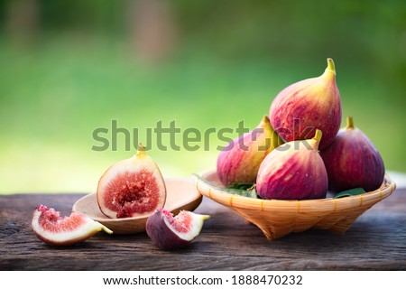 Ripe sweet figs. Healthy mediterranean fig fruit and slice figs on rustic wooden background Stockfoto ©