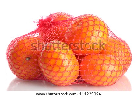 ripe tangerines in bag isolated on white - stock photo