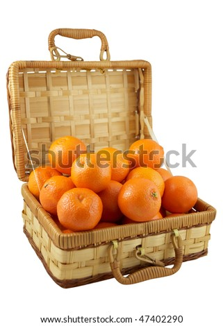 Ripe tangerines in the wicker box isolated on white background