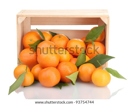 Ripe tasty tangerines with leaves in wooden box dropped isolated on white