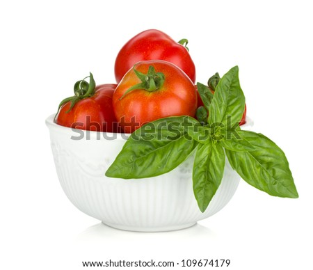 Ripe tomatoes and basil. Isolated on white background