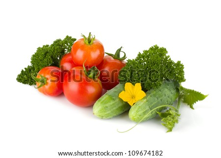 Ripe tomatoes, cucumbers and parsley. Isolated on white background - stock photo