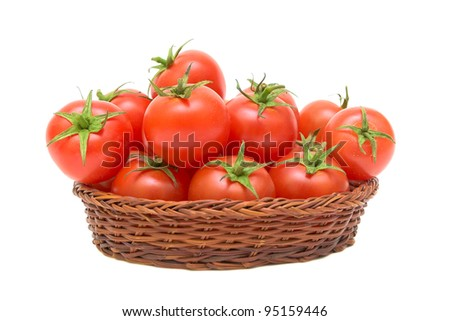 ripe tomatoes in a wicker basket isolated on white background