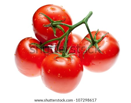 Ripe tomatoes with drops of water isolated over white background
