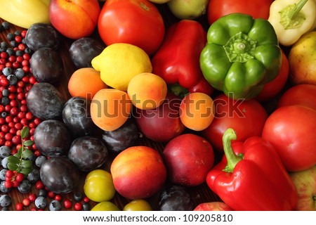 Ripe vegetables and fruits. Organic produce. Tomatoes,  plums, pepper, cowberries, apples and other food.