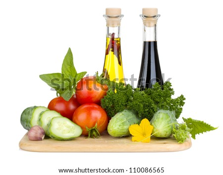 Ripe vegetables and herbs. Isolated on white background