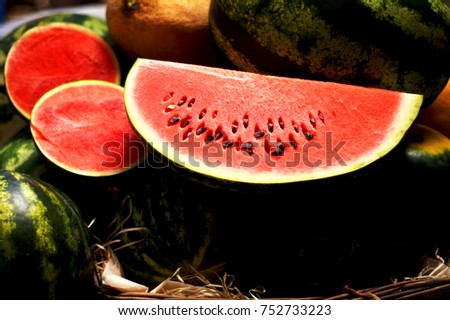 Ripe watermelons, juicy watermelons, watermelons in the market a piece of watermelon with a stone, watermelon background