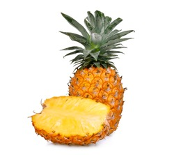 ripe whole and half pineapple with slice isolated on white background