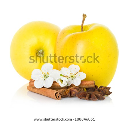 Ripe yellow apples with cinnamon sticks, anise star and apple flowers
