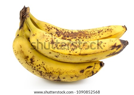 Ripe yellow bananas fruits, bunch of ripe bananas with dark spots on a white background with clipping path.