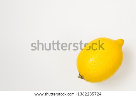 Ripe yellow lemon on white background. There is a place for text. Vegetarianism, healthy lifestyle. #1362235724