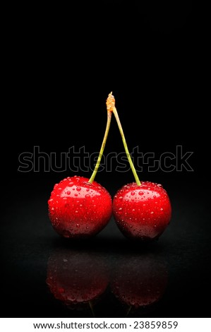 Ripen Cherries Against Black Background Stock Photo ...