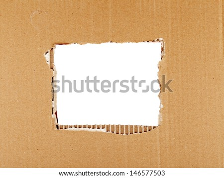 Ripped cardboard with square hole forming frame