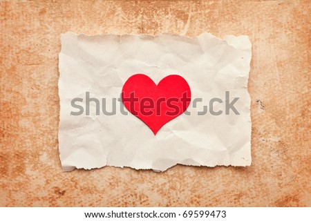 ripped piece of paper on grunge paper background. vintage retro card. Valentine's Day