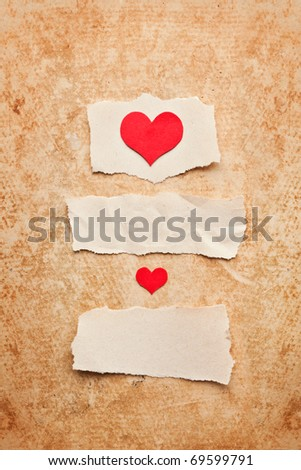 Ripped pieces of paper on grunge paper background. Love letter.Valentine's Day