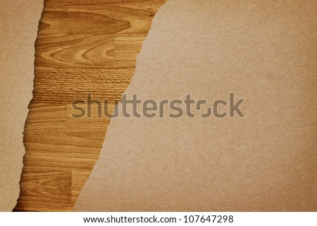 Ripped recycle paper on wood background