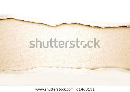 Ripped white paper on brown background. Copy space for advertising message