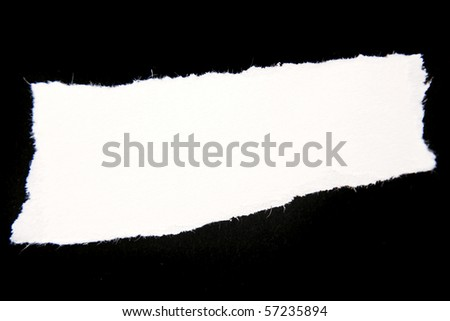 Ripped white paper over dark surface
