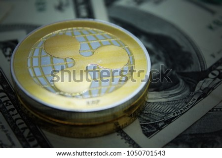 Ripple Coins - Cryptocurrency Macro Shot. Photo Illustration of ripple coins stack on Dollars Money background to illustrate blockchain and cyber currency. #1050701543