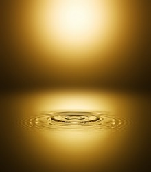 Ripple of the golden surface of the water