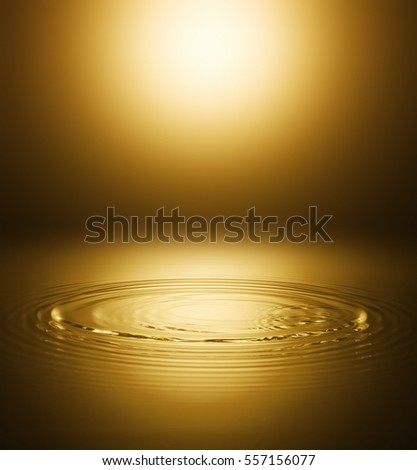 Ripple of the golden surface of the water #557156077