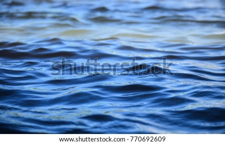 Ripple water of sea wave with sun light. #770692609